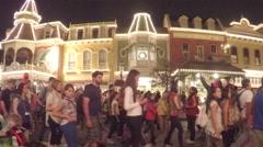 Large crowd on Disney world's Main street leaving park Stock Footage