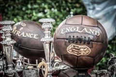 Old soccer rugby balls Stock Photos