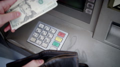 4K Close up of hands taking money from an ATM machine - stock footage