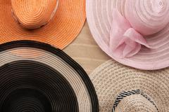 Four  hat lying on the undulating sand Stock Photos