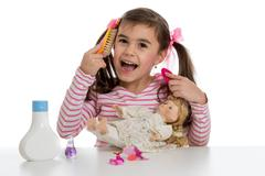 girl playing with doll - stock photo