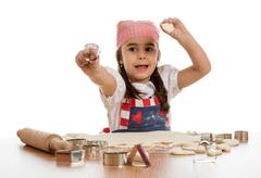 girl making forms out of dough - stock photo