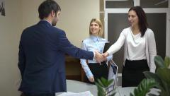 Business partners complete negotiations shaking hands Stock Footage