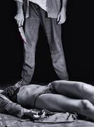 Dead woman with the murderer carrying a knife Stock Photos