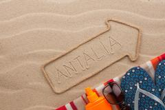 Antalya  pointer and beach accessories lying on the sand - stock photo