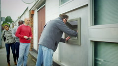 4K People queuing to get cash from an ATM machine - stock footage