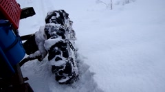 Tractor on the road over the frozen snow - stock footage