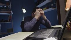 Tired man in office Stock Footage