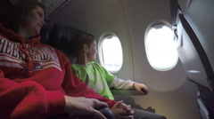 Young boy's first time flying/take off - stock footage