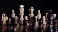 Wooden chessboard and chess pieces turning on a round table Stock Footage
