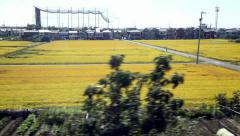 View of passing landscape from a train window, Japan Stock Footage