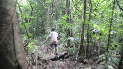 A child walking in the jungle II Stock Footage