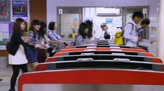 Passengers and ticket counters at train subway station, Kyoto, Japan Stock Footage