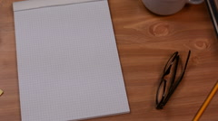 Graph Paper Notebook In Workspace Stock Footage