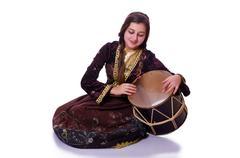 Young azeri woman playing traditional drum nagara Stock Photos