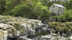 Cenarth falls /flour mill on the river Teifi with exposed rocks due to low water Stock Footage