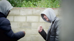 4K 2 suspicious characters carrying out a drug deal on the street in daylight - stock footage