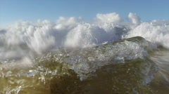 Waves roll into a beach following a big storm in slow motion. - stock footage