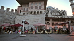 SHOE SHINERS AT NEW MOSQUE, EMINONU, ISTANBUL, TURKEY Stock Footage