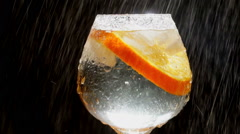 Glass with cold water and Orange - Stock Video Stock Footage