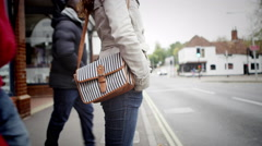 4K Woman on city street is unaware that her purse has been stolen by pickpocket Stock Footage
