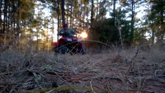 Man on ATV close drive by in Forest Stock Footage