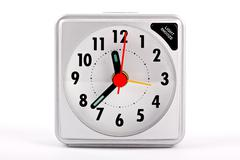 Travel alarm clock on white background Stock Photos