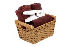 Rolled towels in a basket isolated Stock Photos