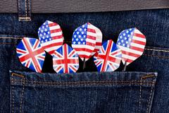 USA and UK darts in jeans pocket Stock Photos