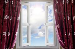 Window open with a view to sky and sun - stock photo