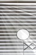 Sunlight through bathroom blinds Stock Photos
