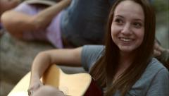 Girl Makes Funny Face, Plays Guitar, Laughs With Her Friend (Slow Motion) Stock Footage