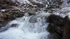 4k, Waterfall in mountain locality in winter Stock Footage