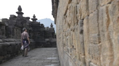 Borobudur - Tourist Looking at the Wall Stock Footage