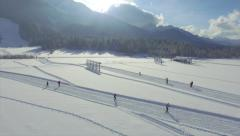 AERIAL: People cross countri skiing in sunny winter - stock footage