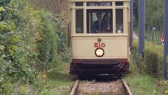 Antique train/trolley riding towards camera - stock footage