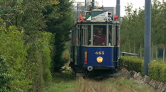Antique trolley riding towards camera - stock footage