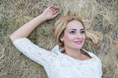 Stock Photo of Beautiful young woman in the hay