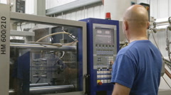 man operating injection moulding machine - stock footage