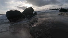 Water level view of waves crashing and rolling into shore in slow motion. Stock Footage