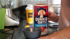 Young Male Preparing Oatmeal In Kitchen - stock footage
