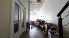 Dolly Shot of Hallway Filled With Moving Boxes In Loft Stock Footage