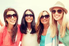 Stock Photo of girls in shades having fun on the beach