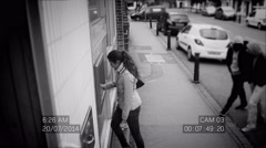 4K CCTV footage of suspicious males stealing from woman at ATM machine Stock Footage