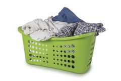 Green Laundry Basket with clothes - stock photo
