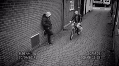 4K CCTV footage of 2 suspicious characters carrying out a drug deal - stock footage