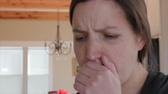 Sick woman blows nose in kleenex Stock Footage