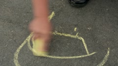 Child Drawing with Chalk on Pavement Stock Footage