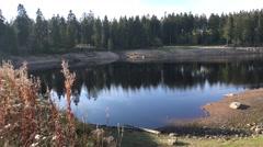 4k Oderteich lake mountain range Harz panning shot Stock Footage