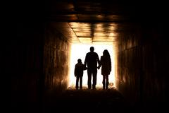 Family holding hands in the tunnel Stock Photos